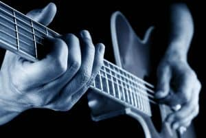 Man playing Left-Handed-Acoustic-Guitars